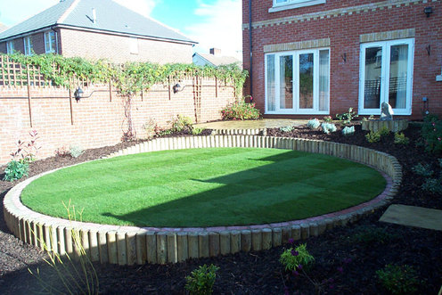 lawn, sloping garden, retaining wall, planting, garden design