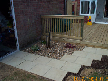A new deck with timber balustrade and a small water feature to add intrest to a dull corner