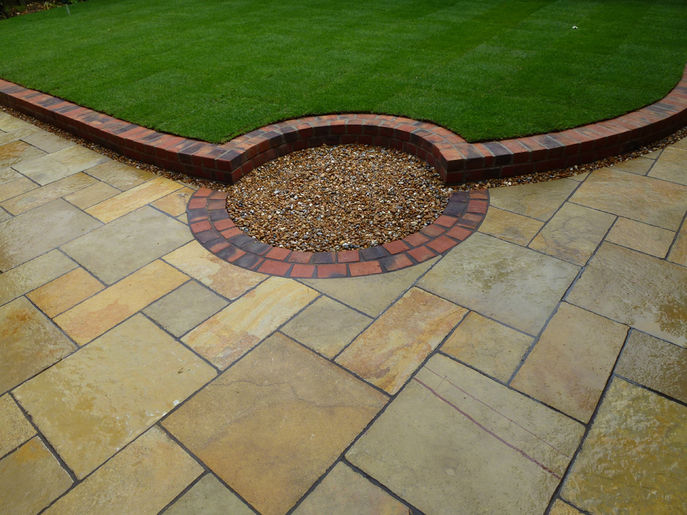 limestone paving, patio, brick wall, lawn, feature