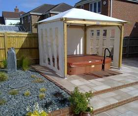 smooth stone paving, gazebo, hot tub, steps, planting