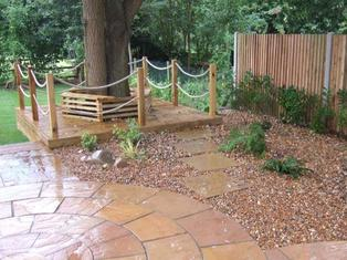 paving circle, stone, tree seat, rope, gravel, planting, garden