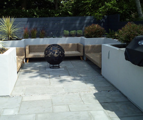 A garden design and landscape project with seating, lighting, paving, raised beds, barbeque, fire pit, planting, screening