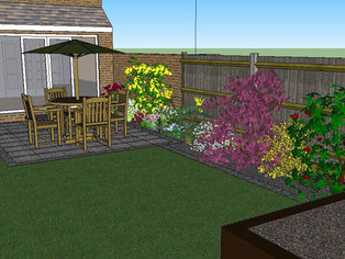 A corner of a garden design showing a new patio with brick edged borders and a raised vegetable garden.