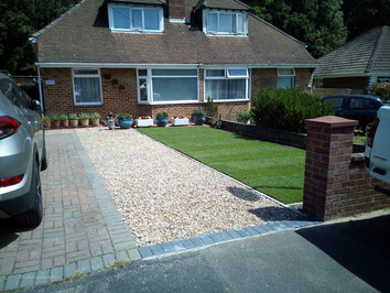 A front garden with extended gravel drive and new lawn