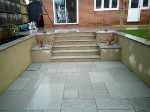 Complete garden makeover in Whiteley with paving, retaining walls, Sunken garden, artificial grass, fencing and planting
