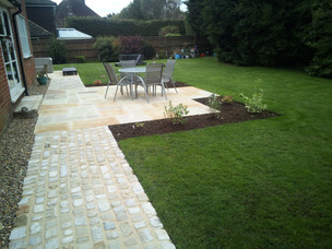 Examples of Wyld Landscapes work with paving, hedging, planting, paths, shed, cobbles, lawn, fencing, pergola, design