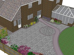 Part of a large garden design showing a large patio with a cicular paved feature and a curved path leading further down the garden.